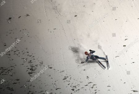 David Siegel of Germany falls in the finish area during the team competition of the FIS Ski Jumping World Cup in Zakopane, Poland, 19 January 2019.