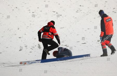 David Siegel of Germany receives medical treatment after crashing during the team competition of the FIS Ski Jumping World Cup in Zakopane, Poland, 19 January 2019.