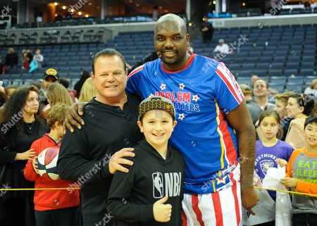 Harlem Globetrotters forward, Spider (42), and former Professional Wrestler, Jerry ''The King'' Lawler (left), during the exhibition game against the Washington Generals at Fed Ex Forum in Memphis, TN. Kevin Langley/Sports South Media/CSM