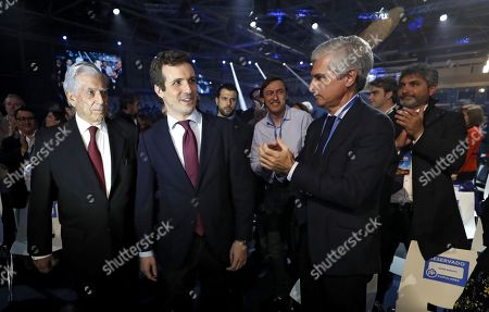 Leader of the Spanish People's Party (PP) Pablo Casado (C), Peruvian writer and Noble Laureate Mario Vargas Llosa (L) and Freedom Foundation President Adolfo Suarez Illana (2-R), son of late Spanish former Prime Minister Adolfo Suarez, attend the second day of the PP's National Convention at the IFEMA Convention and Congress Center in Madrid, Spain, 19 January 2019. The three-day congress, running until 20 January, was organized to look for an 'ideological rearmament'.