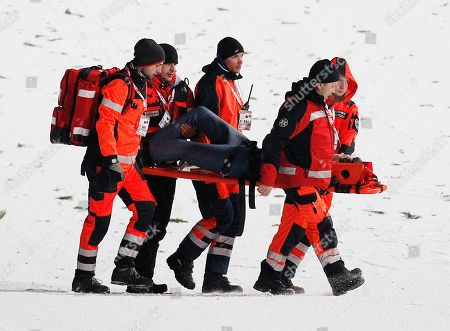 Rescue medics carry Germany's David Siegel after he fell during his final jump of the 17th World Cup Ski Jumping competition in Zakopane, Poland