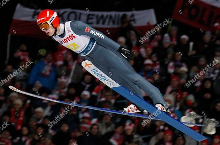 Germany's David Siegel soars through the air during the 17th World Cup Ski Jumping Large Hill Team competition in Zakopane, Poland