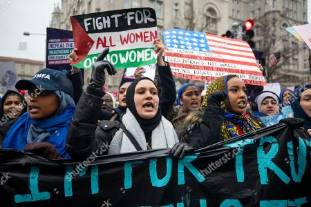 Supporters of the annual Women's March walk by the Trump Hotel in Washington, DC, USA, 19 January 2019. It is the third time the organization has hit the streets of DC to protest the policies of US President Donald J. Trump. Though this year the organization has come under scrutiny for co-president Tamika Mallory's association with Nation of Islam leader Louis Farrakhan.