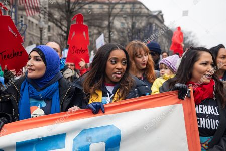 Co-president of the 2019 Women's March Tamika Mallory (C) walks by the Trump Hotel during the organization's third annual protest against the policies of US President Donald J. Trump in Washington, DC, USA, 19 January 2019. Mallory has come under scrutiny for her association with Nation of Islam leader Louis Farrakhan, who is widely known for making anti-semitic comments.