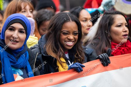 Stock Image of Co-president of the 2019 Women's March Tamika Mallory (C) prepares to walk down Pennsylvania Avenue for the organization's third annual protest against the policies of US President Donald J. Trump in Washington, DC, USA, 19 January 2019. Mallory has come under scrutiny for her association with Nation of Islam leader Louis Farrakhan, who is widely known for making anti-semitic comments.