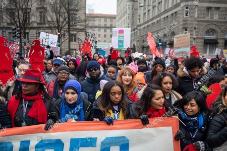 Stock Photo of Co-president of the 2019 Women's March Tamika Mallory (C) walks by the Trump Hotel during the organization's third annual protest against the policies of US President Donald J. Trump in Washington, DC, USA, 19 January 2019. Mallory has come under scrutiny for her association with Nation of Islam leader Louis Farrakhan, who is widely known for making anti-semitic comments.