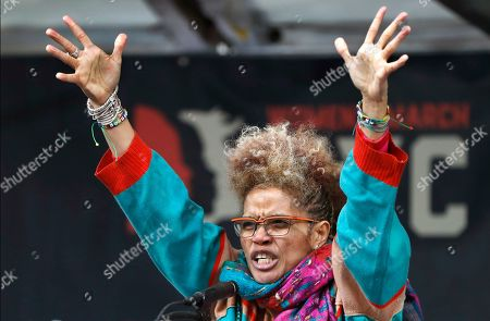 Stock Image of Staceyann Chin, a spoken-word poet, performing artist and LGBT rights political activist reads a poem at a rally organized by Women's March NYC at Foley Square in Lower Manhattan, in New York