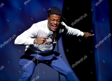 DC Young Fly performs on stage