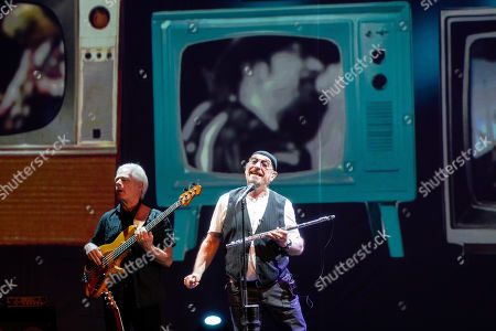 Stock Photo of David Goodier (L) and Ian Anderson of British folk rock band Jethro Tull perform during their concert in Budapest Congress Center in Budapest, Hungary, 19 January 2019.