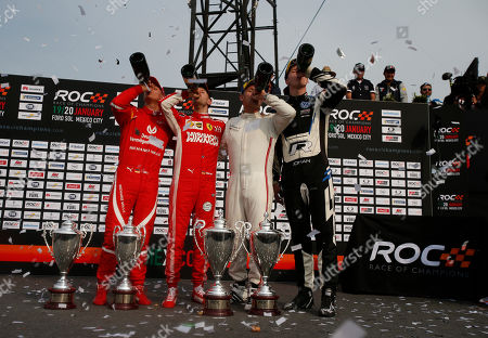 Team Nordic's Johan Kristoffersson of Sweden, right, and Tom Kristensen of Denmark, second right, celebrate their victory along with runners-up, Sebastian Vettel, second left, and Mick Schumacher, left, of Team Germany, in the Race of Champions Nations Cup in Foro Sol in Mexico City, . The Race of Champions is being held for the first time in Latin America