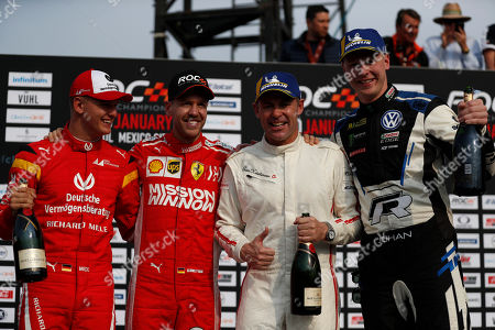 Stock Image of Team Nordic's Johan Kristoffersson of Sweden, right, and Tom Kristensen of Denmark, second right, celebrate their victory along with runners-up, Sebastian Vettel, second left, and Mick Schumacher, left, of Team Germany, in the Race of Champions Nations Cup in Foro Sol in Mexico City, . The Race of Champions is being held for the first time in Latin America