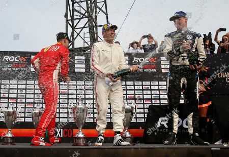 Team Nordic's Tom Kristensen of Denmark, center, celebrates with teammate Johan Kristoffersson of Sweden, right, and second place finishers, Team Germany's Sebastian Vettel, left, and Mick Schumacher, unseen, in the Race of Champions Nations Cup in Foro Sol in Mexico City, . The Race of Champions is being held for the first time in Latin America
