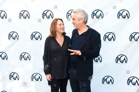 Lucy Fisher, Alfonso Cuaron. Lucy Fisher, PGA Co-President and Alfonso Cuaron at the 2019 Producers Guild of America Nominees Breakfast at The Skirball Cultural Center, in Los Angeles