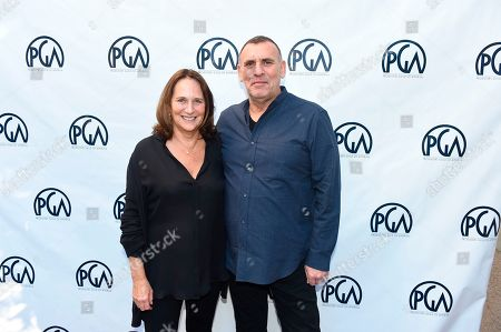 Lucy Fisher, Graham King. Lucy Fisher, PGA Co-President and Graham King at the 2019 Producers Guild of America Nominees Breakfast at The Skirball Cultural Center, in Los Angeles