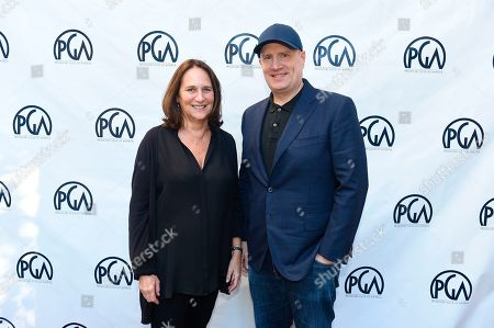 Kevin Feige, Lucy Fisher. Lucy Fisher, PGA Co-President and Kevin Feige at the 2019 Producers Guild of America Nominees Breakfast at The Skirball Cultural Center, in Los Angeles