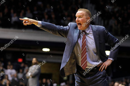 St. John's coach Chris Mullin shouts during the second half of the team's NCAA basketball game against Butler, Indianapolis. Butler won 80-71
