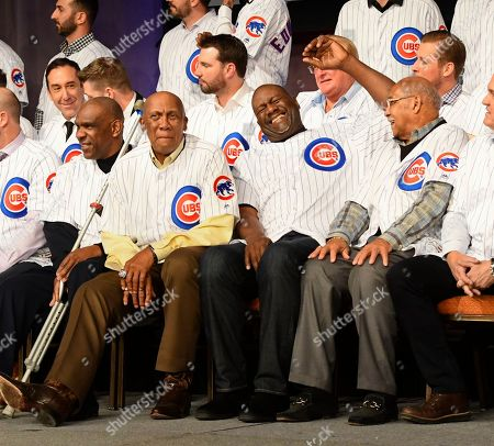 Andre Dawson, Ferguson Jenkins, Lee Smith, Billy Williams. Chicago Cubs' players from left, Andre Dawson, Ferguson Jenkins, Lee Smith and Billy Williams laugh during the team's annual convention, in Chicago