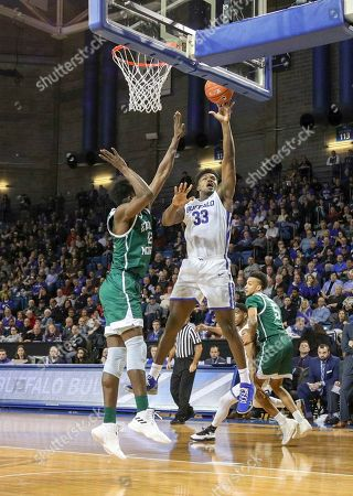 Buffalo Bulls forward Nick Perkins (33) shoots over Eastern Michigan Eagles center Boubacar Toure (12) during the second half of play in the NCAA Basketball game between the Eastern Michigan Eagles and Buffalo Bulls at Alumni Arena in Amherst, N.Y. (Nicholas T. LoVerde/UB Athletics)