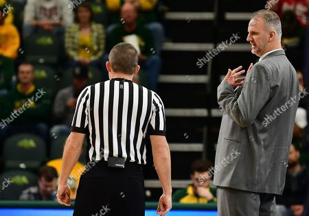 North Dakota Fighting Hawks head coach Brian Jones discusses a call with an official during a NCAA men's basketball game between the University of North Dakota Fighting Hawks and the North Dakota State Bison at the Scheels Center, Fargo, ND. NDSU defeated UND 67-65