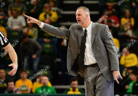 North Dakota Fighting Hawks head coach Brian Jones directs his players during a NCAA men's basketball game between the University of North Dakota Fighting Hawks and the North Dakota State Bison at the Scheels Center, Fargo, ND. NDSU defeated UND 67-65