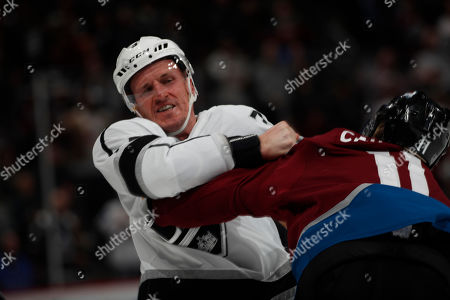 R m. Los Angeles Kings defenseman Dion Phaneuf (3) and Colorado Avalanche left wing Matt Calvert (11) in the third period of an NHL hockey game, in Denver. Colorado won 7-1