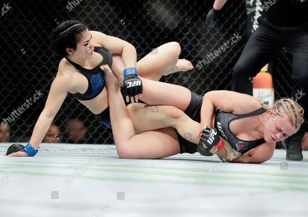 Rachael Ostovich, left, grapples with Paige Vanzant during the first round of a women's flyweight mixed martial arts bout at UFC Fight Night, in New York. Vanzant stopped Ostovich in the second round
