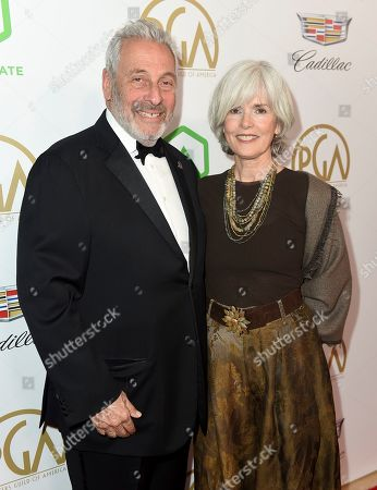 Stock Picture of Hawk Koch, Molly Jordan Koch. Hawk Koch, lett, and Molly Jordan Koch arrive at the 30th Producers Guild Awards presented by Cadillac at the Beverly Hilton, in Beverly Hills, Calif
