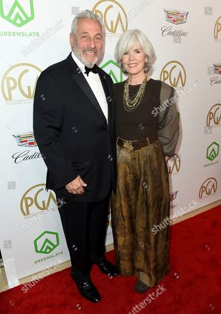 Stock Photo of Hawk Koch, Molly Jordan Koch. Hawk Koch, lett, and Molly Jordan Koch arrive at the 30th Producers Guild Awards presented by Cadillac at the Beverly Hilton, in Beverly Hills, Calif