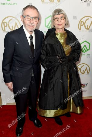 John Toll, Lois Burwell. John Toll, left, and Lois Burwell arrive at the 30th Producers Guild Awards presented by Cadillac at the Beverly Hilton, in Beverly Hills, Calif