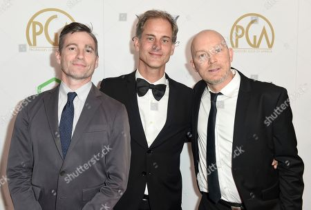 Stock Image of Josh Lowell, Philipp Manderla, Peter Mortimer. Josh Lowell, from left, Philipp Manderla, and Peter Mortimer arrive at the 30th Producers Guild Awards presented by Cadillac at the Beverly Hilton, in Beverly Hills, Calif
