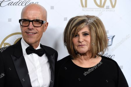 Stock Image of Donald de Line, Amy Pascal. Donald de Line, left, and Amy Pascal arrive at the Producers Guild Awards, at the Beverly Hilton Hotel in Beverly Hills, Calif