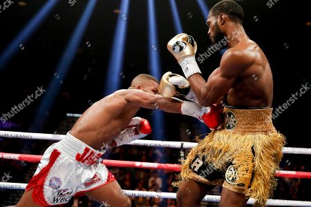 Badou Jack, left, hits Marcus Browne in a light heavyweight boxing bout, in Las Vegas