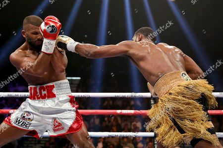 Badou Jack blocks a punch from Marcus Browne in a WBA light heavyweight boxing bout, in Las Vegas