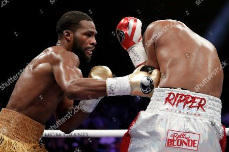 Marcus Browne hits Badou Jack during a light heavyweight boxing bout, in Las Vegas