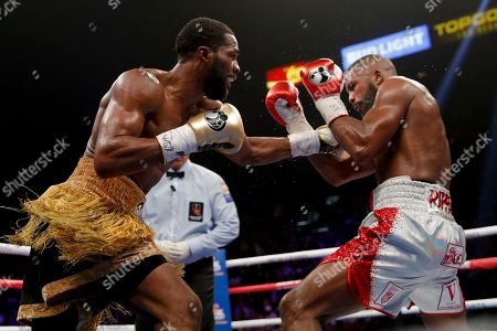 Marcus Browne, left, hits Badou Jack during a WBA light heavyweight boxing bout, in Las Vegas
