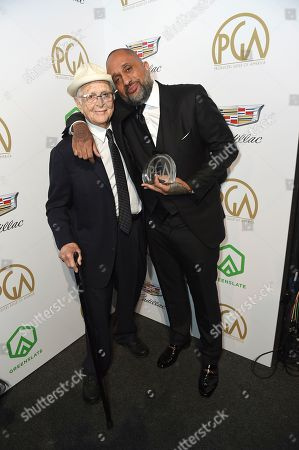 Norman Lear, Kenya Barris. Norman Lear, left, and Kenya Barris pose with the Visionary Award at the 30th Producers Guild Awards presented by Cadillac at the Beverly Hilton, in Beverly Hills, Calif