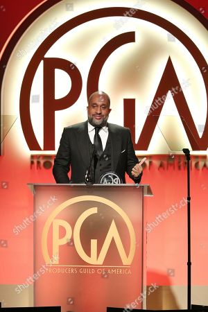 Kenya Barris accepts the Visionary Award at the 30th Producers Guild Awards presented by Cadillac at the Beverly Hilton, in Beverly Hills, Calif