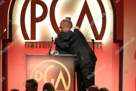 Norman Lear, Kenya Barris. Norman Lear presents the Visionary Award to Kenya Barris at the 30th Producers Guild Awards presented by Cadillac at the Beverly Hilton, in Beverly Hills, Calif