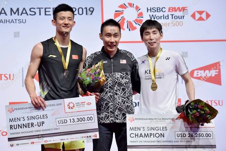 Chen Long, Son Wan Ho, Lee Chong Wei. Chen Long of China, left, and Son Wan Ho of South Korea poses next to Lee Chong Wei of Malaysia during the men's singles final of the Malaysia Masters badminton tournament in Kuala Lumpur, Malaysia