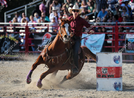 Dana Davis (58) competes in the WPRA Barrel Racing event during the 70th Annual Homestead Championship Rodeo at the Doc DeMilly Rodeo Arena at Harris Field in Homestead, Florida