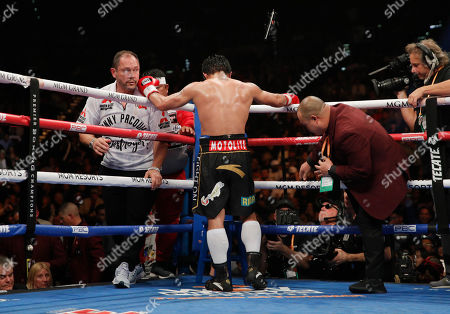 Manny Pacquiao rests between rounds against Adrien Broner, not pictured, in a welterweight championship boxing match, in Las Vegas