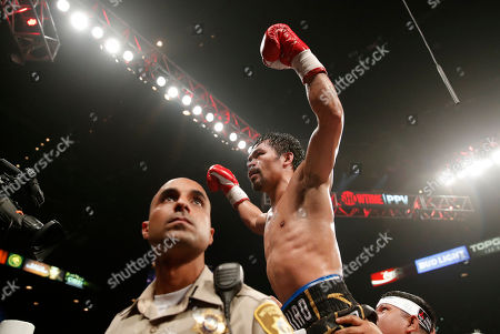 Manny Pacquiao celebrates after defeating Adrien Broner in a welterweight championship boxing match, in Las Vegas