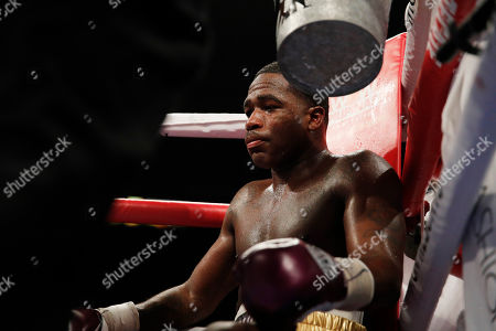 Adrien Broner rests between rounds against Manny Pacquiao in a welterweight championship boxing match, in Las Vegas