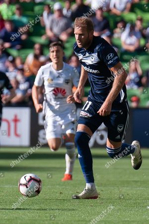Melbourne Victory forward Ola Toivonen (11) runs the ball downfield during the Hyundai A-League Round 14 soccer match