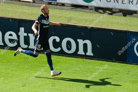Melbourne Victory forward Ola Toivonen (11) celebrates the opening goal during the Hyundai A-League Round 14 soccer match