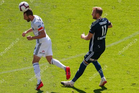Melbourne Victory forward Ola Toivonen (11) competes for the ball during the Hyundai A-League Round 14 soccer match