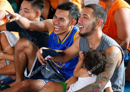 Fans react during the WBA Welterweight Championship boxing match between Filipino Manny Pacquiao and American Adrien Broner, in Manila, Philippines, which was beamed live via satellite from Las Vegas. Pacquiao retained the title via unanimous decision