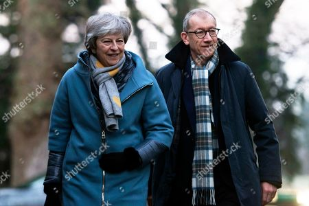 d2210947b837 Britain s Prime Minister Theresa May (L) and husband Philip May (R) arrive