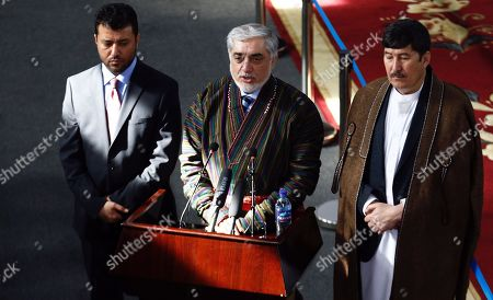 Afghanistan's chief executive Dr. Abdullah Abdullah, (C) as presidential candidate, Babur Farahmand, (R) as first vice president candidate, and Asadullah Sadaty (L) as second vice president speak after signing their electoral ticket for the upcoming Afghanistan's presidential election scheduled for 20 July 2019, at the election commission central office in Kabul, Afghanistan, 20 January 2019.