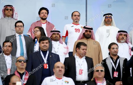 His Royal Highness Crown Prince Al Hussein bin Abdullah II (2L -Back) of Jordan and His Royal Highness Prince Ali Bin Al Hussein (C-Back) the President of the Jordan Football Association attend the 2019 AFC Asian Cup round of 16 soccer match between Jordan and Vietnam in Dubai, United Arab Emirates on 20 January 2019.